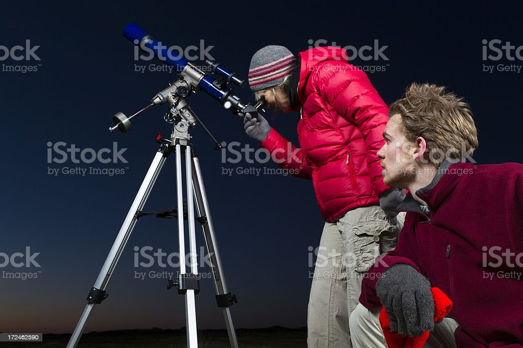 Two amateur astronomers with telescope at night royalty-free stock photo