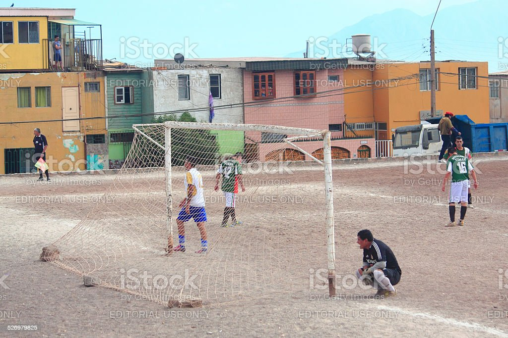 two amateur football teams play on the field in Antofagasta, stock photo