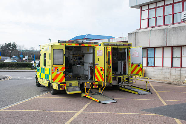 Two ambulances outside A&E at the NHS hospital Bournemouth stock photo