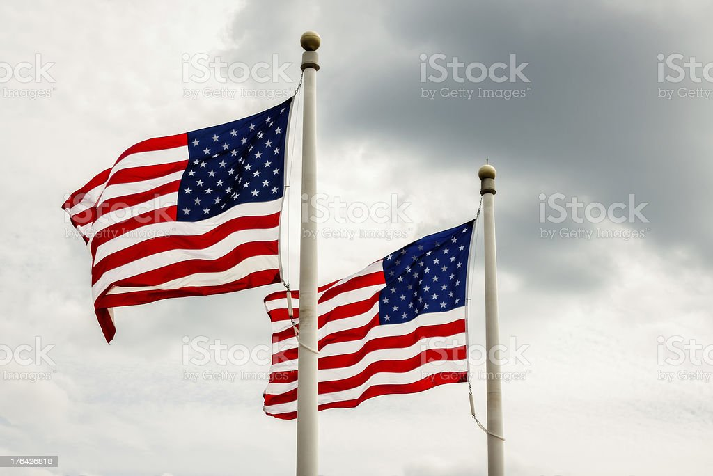 Two American Flags on a Cloudy Day royalty-free stock photo