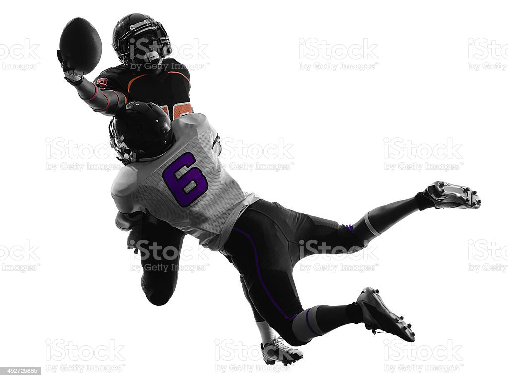 two american football players tackle silhouette stock photo
