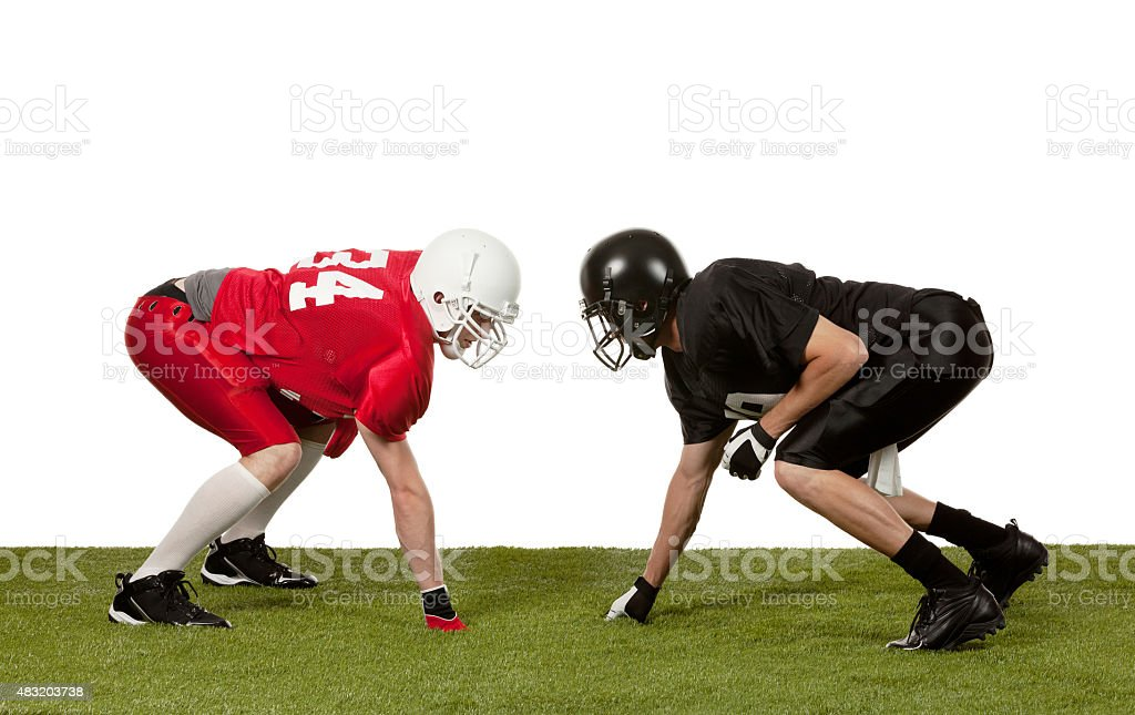 Two American football players tackling stock photo
