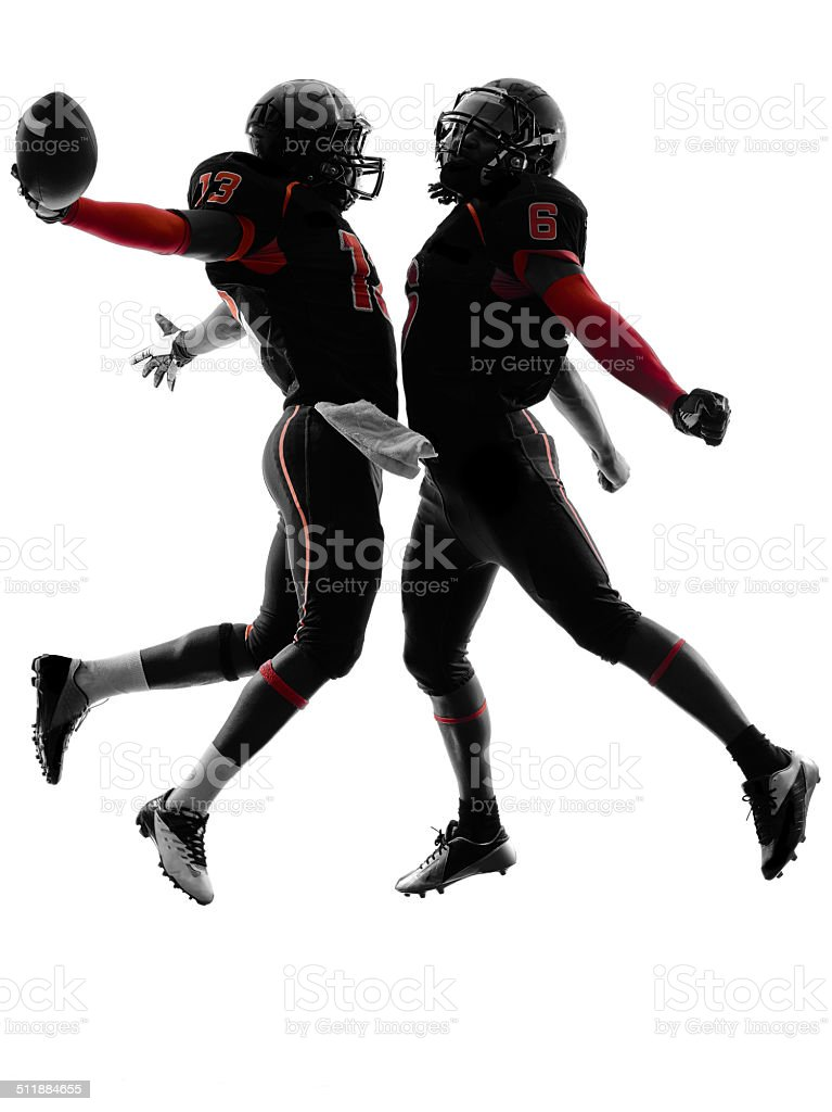 two american football players touchdown celebration silhouette stock photo