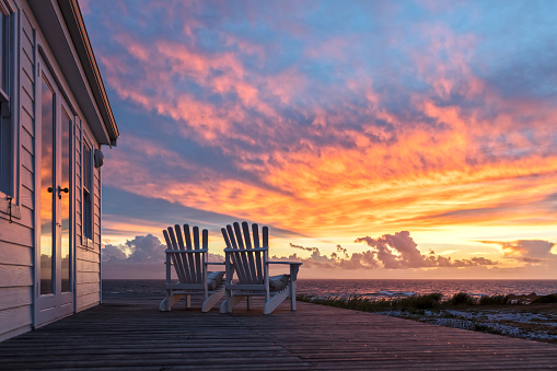 Two Ampty Chairs Facing Magnificent Sunset View at Beach