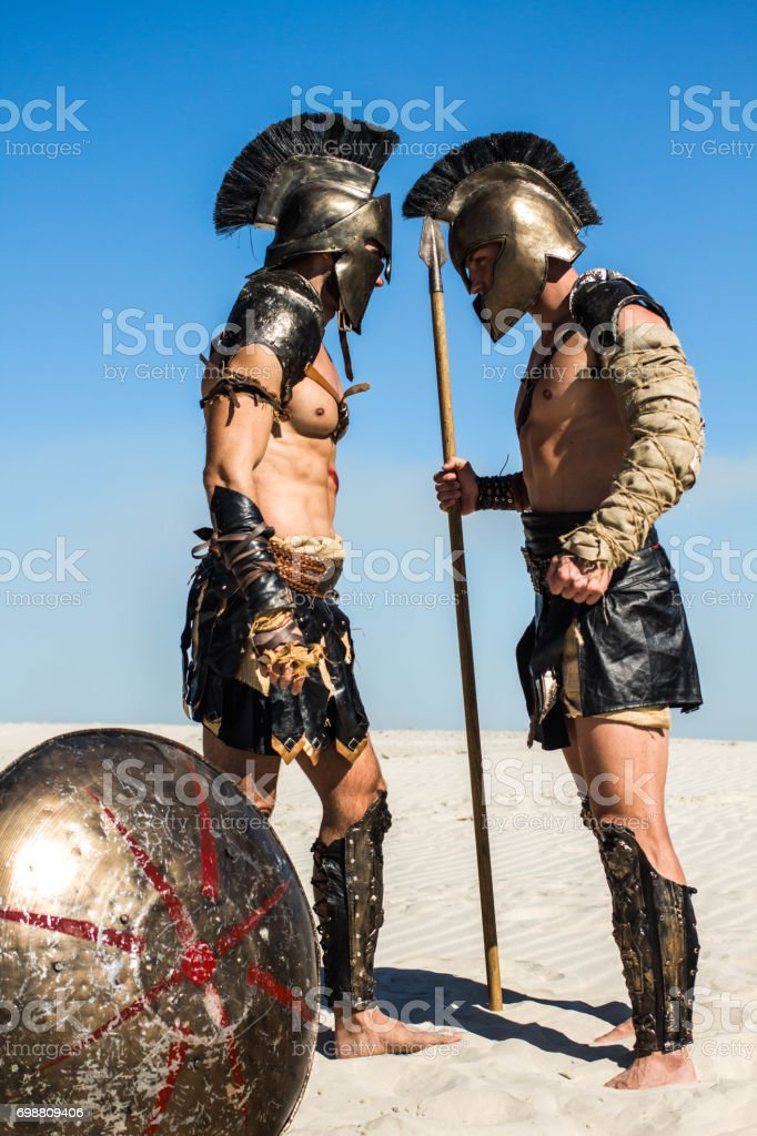 Two ancient Roman warriors face to face stock photo