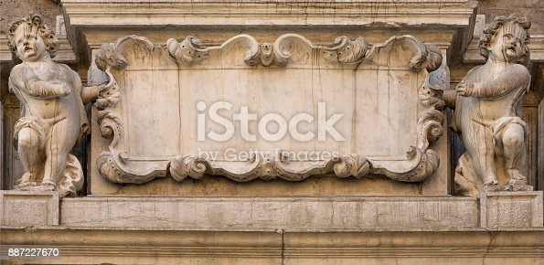 istock Two Angels Holding an Empty Banner 887227670