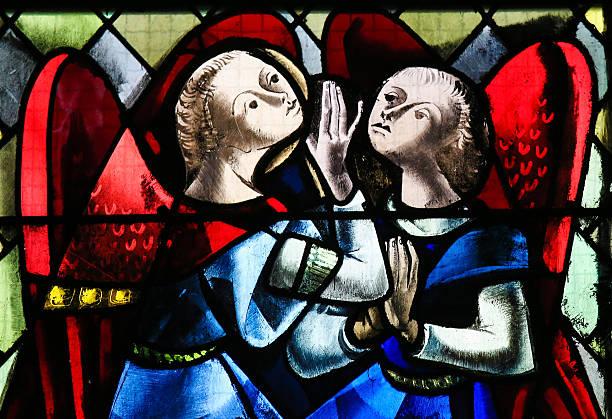 two angels - stained glass - psalm stock-fotos und bilder