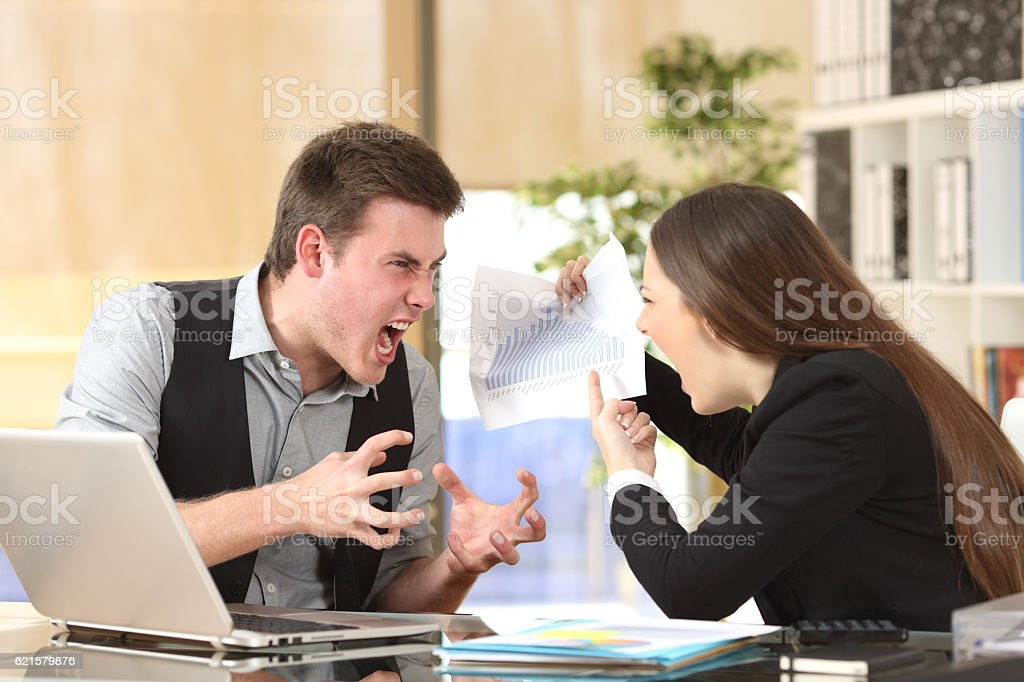 Two angry businesspeople arguing furious stock photo