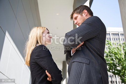 istock Two angry caucasian business people 91218547