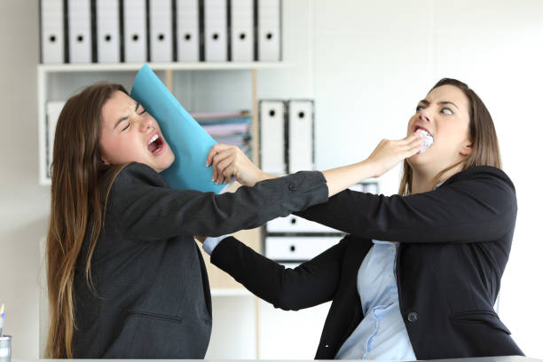 two angry executives fighting at office - fighting stock photos and pictures