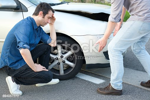 1047083324 istock photo Two angry men arguing after a car crash 694057272