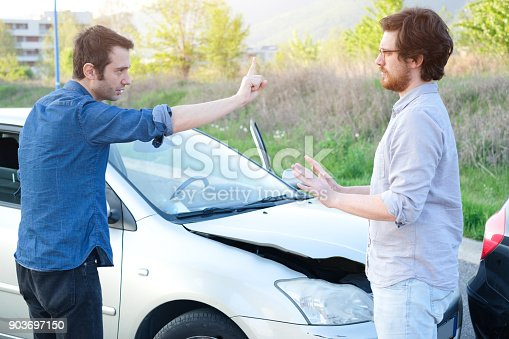 1047083324 istock photo Two angry men arguing after a car crash 903697150