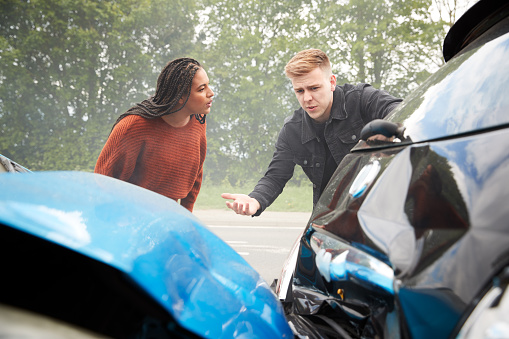 istock Two Angry Motorists Arguing Over Responsibility For Car Accident 1156652288
