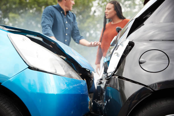 Two Angry Motorists Arguing Over Responsibility For Car Accident stock photo