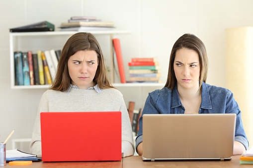 Two Angry Students Looking Each Other With Hate Stock Photo - Download Image Now