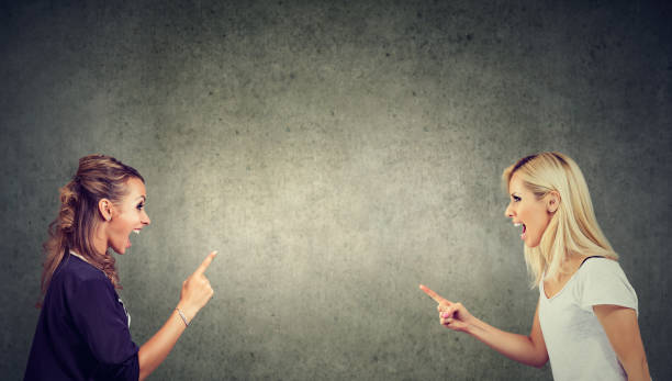 two angry women fighting screaming at each other - row of heads stock photos and pictures