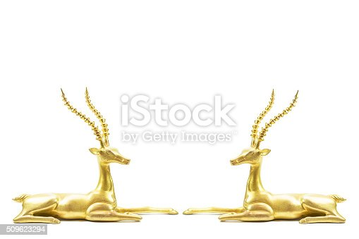 istock Two antique grunge brass deers sculpture facing each other 509623294