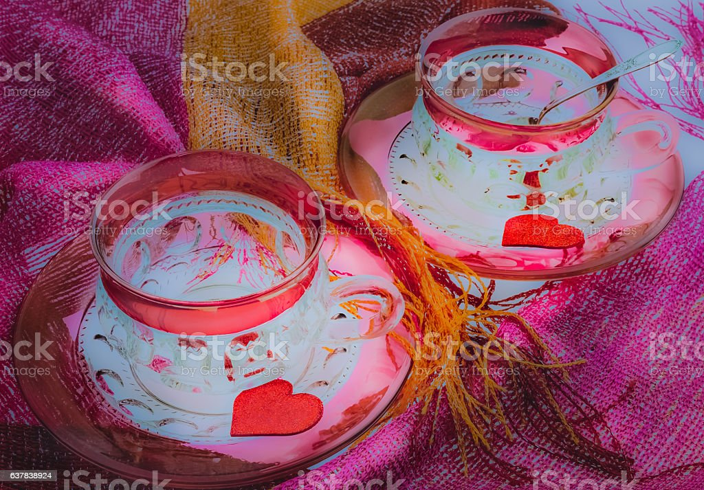 Two antique Ruby glass cups and saucers with hearts (P) stock photo