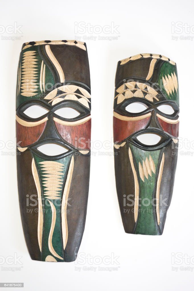 Two Antique Small Tribal Masks stock photo