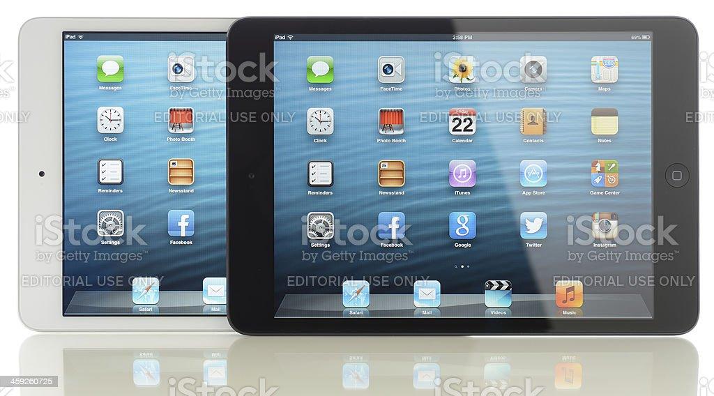 Two Apple iPad Mini displaying home screen royalty-free stock photo