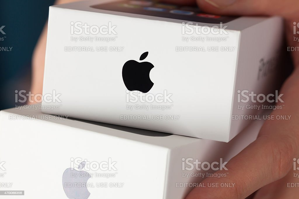 Two Apple iPhone boxes in woman's hands stock photo