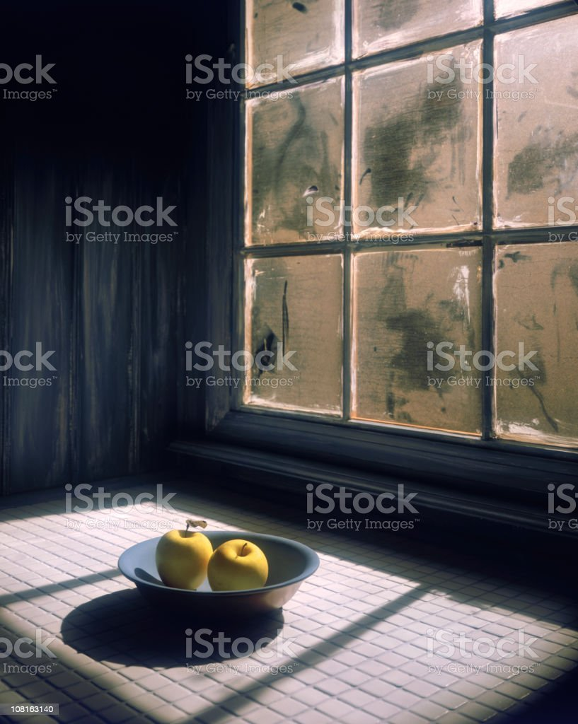 Two Apples in Bowl by Frosty Window stock photo