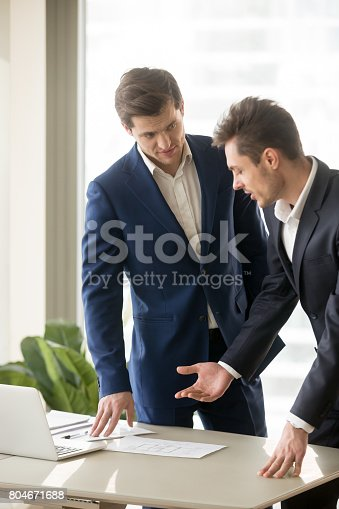 istock Two appraisers working on architectural project with laptop, building plan 804671688