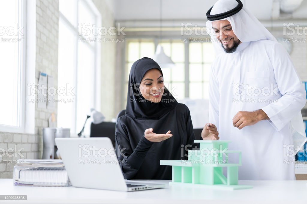 Two Arab architects  discusing project stock photo