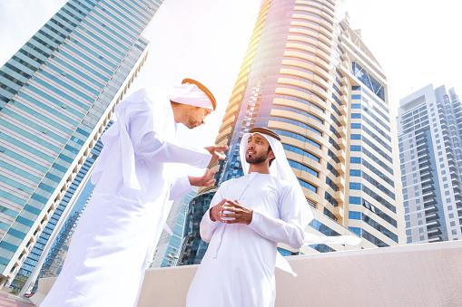 Two arab business people on the street.  iStockalypse Dubai - UAE 2015