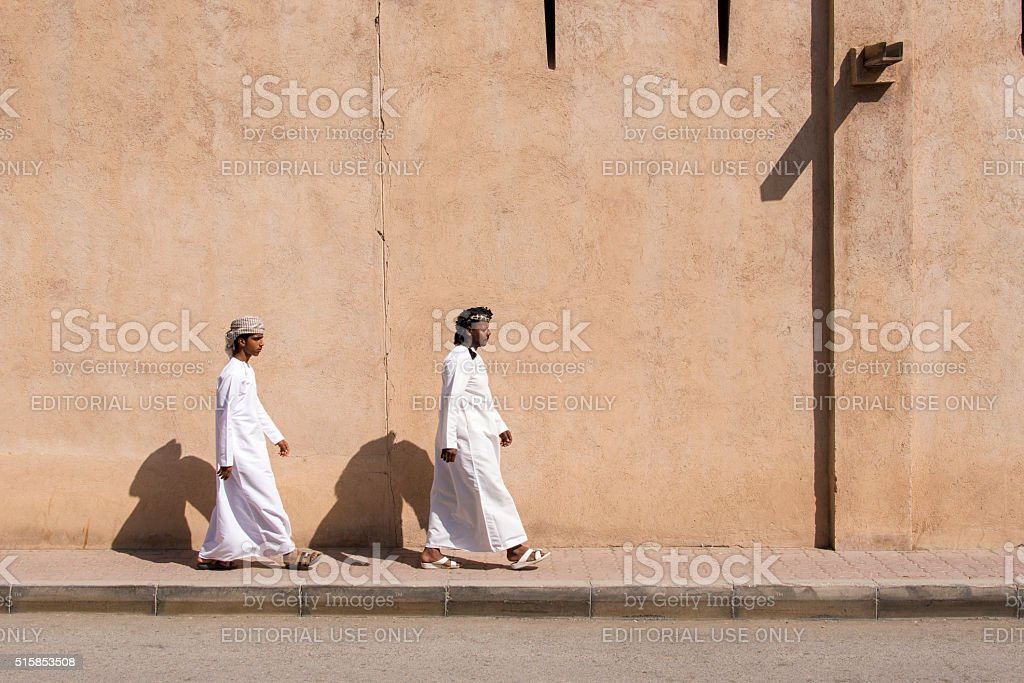 Two Arab men in traditional clothing stock photo