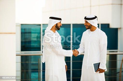 471250190istockphoto Two Arab Men Shaking Hands 483863066