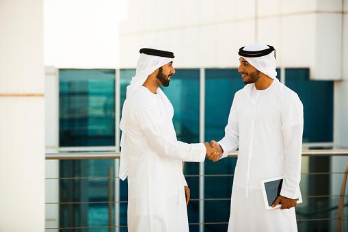 471250190 istock photo Two Arab Men Shaking Hands 483863066