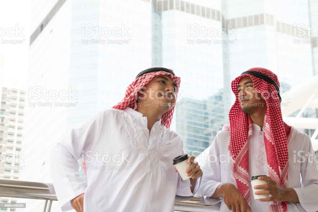 Two Arabian businessman are celebrating their project together is the city stock photo