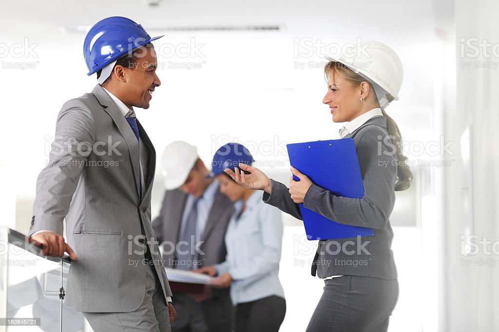 Two architect discussing, changing experience. royalty-free stock photo