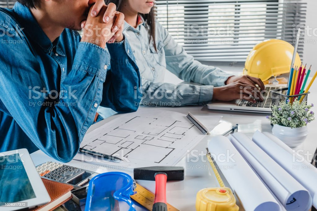 Two architect engineer design working and discussing data and laptop...