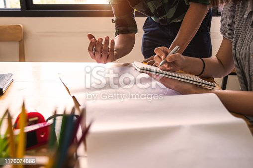 istock Two Architect man working with blueprints for architectural plan, engineer sketching a construction project concept. 1176074666