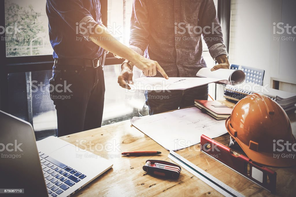 Two Architect man working with compasses and blueprints for architectural plan,engineer sketching a construction project concept. royalty-free stock photo