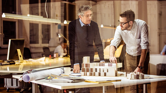 532257236 istock photo Two architects discussing new project 490507452