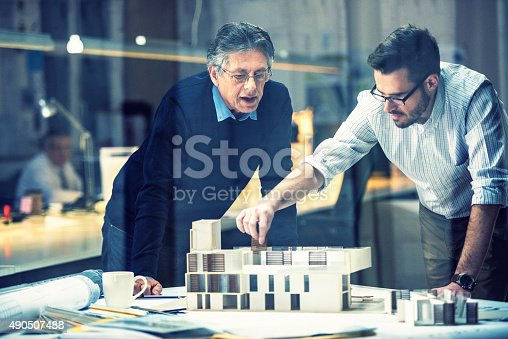 istock Two architects discussing new project 490507488