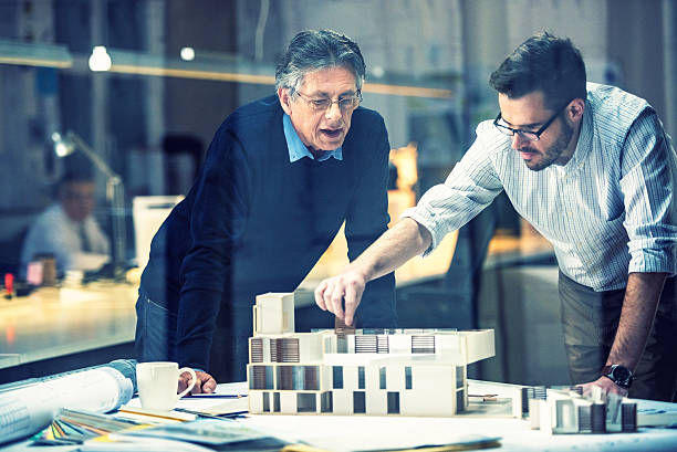 Two architects discussing new project​​​ foto