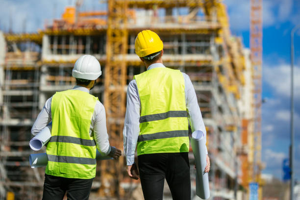 Two architects looking toward construction site stock photo