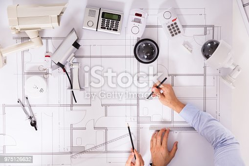 istock Two Architects Planning Project On Blueprint 975126632