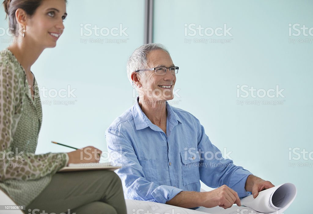 Two architects with blueprint at office royalty-free stock photo