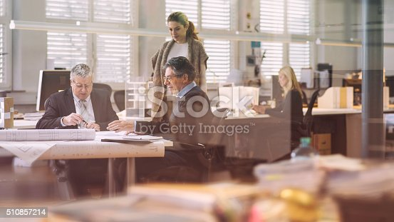 532257236istockphoto Two architects with their client in the office 510857214