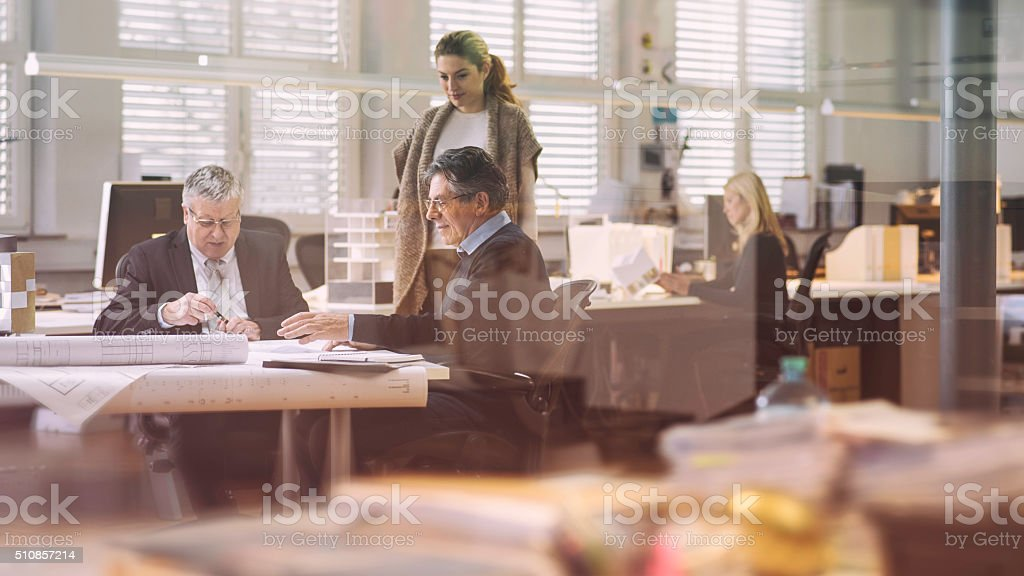 Two architects with their client in the office stock photo