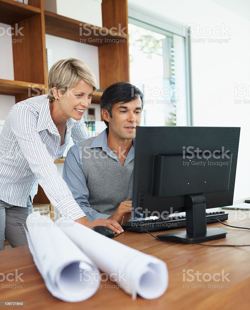 Two architects working together on a computer royalty-free stock photo