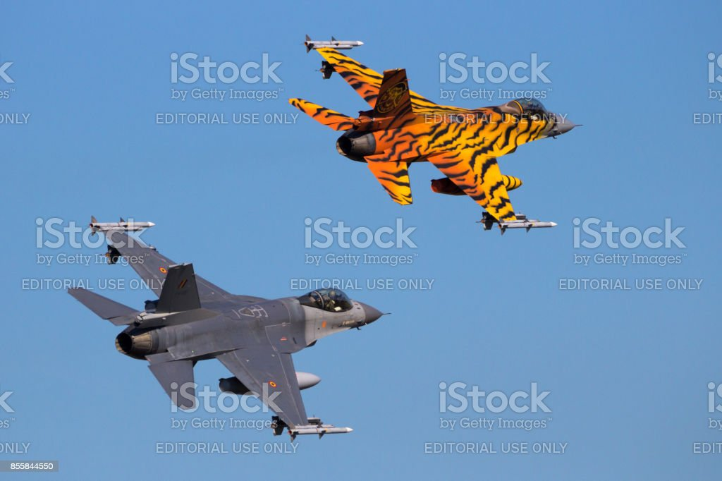 Two armed Belgian Air Force F-16 fighter jets stock photo