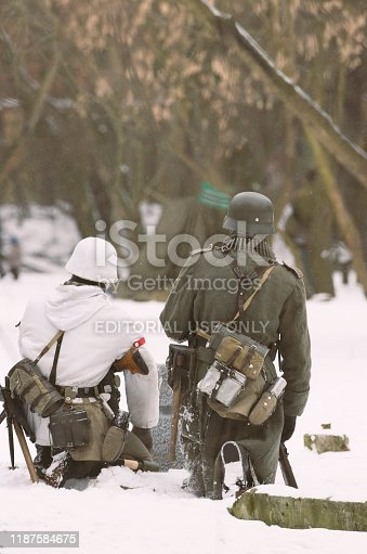 St. Petersburg (Russia) - February 23, 2017: Military historical reconstruction of events of World War II. Two armed soldiers of the Wehrmacht sitting back