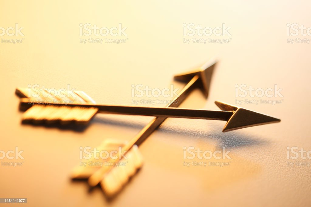 Two Arrows Criss Crossing Each Other stock photo