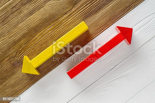 istock Two arrows pointing in opposite directions. 831601736